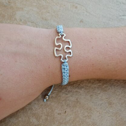 Blue Woven Puzzle Piece Bracelet on arm