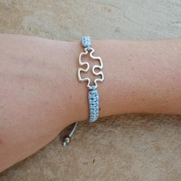 Blue Woven Puzzle Piece Bracelet on arm