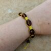 Yellow Woven Bracelet with Maroon Glass Beads (Handmade by Lilla-Rose) on arm